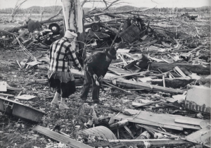 Colfax residents picking through the wreckage. In the background is a vehicle that was thrown. Credit: University of Wisconsin