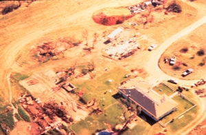 A pair of homes swept away in Kellerville. These homes were likely poorly anchored, however. Note the lack of damage to the stronger structure to the right. The tornado likely reach its peak over open country to the southwest. Credit: NOAA