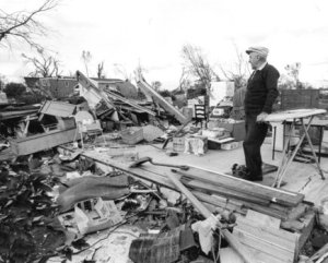 Guy Atkinson surveys his demolished home in Oelwein. Credit: KCRG-TV