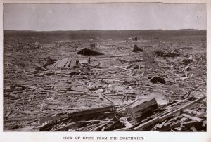 Debris from Pomeroy strewn across a neighboring field Credit: NOAA