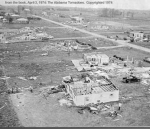 One of a couple of pictures of some lighter damage in the Tanner area, probably F2 to F3, with some homes in the background almost entirely destroyed. Credit: NOAA