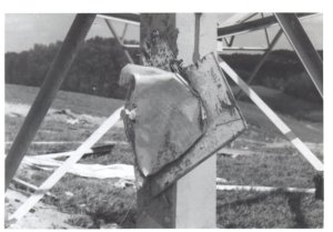 The tornado threw this piece of metal debris with such force that it was speared on a bolt on a steel truss tower. Several of these towers were snapped off at the base and thrown. Credit: sciotoville.org