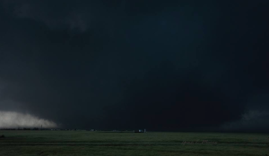 A view of the massive tornado moving over open country south of El Reno. Credit: Gene Moore