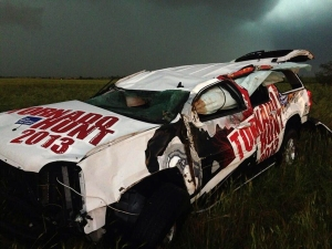 The SUV of Mike Bettes' Tornado Hunt chase team after it was thrown 200 yards by the tornado. Everyone inside miraculously survived. Others weren't so lucky. Credit: NBC News