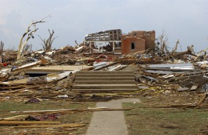 A destroyed house in Greensburg. The brick home behind it has also been severely damaged. Credit: accesskansas.org