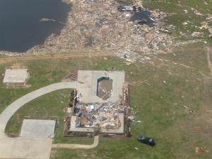 This well-built brick home was completely swept away, the debris thrown forty yards away. Credit: NOAA