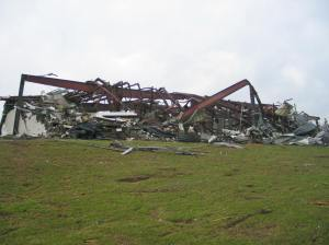 This warehouse was completely leveled and steel beams were twisted or snapped off at the base. Credit: NOAA