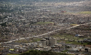 An aerial view of the devastation around St. John's Regional Medical Center. The hospital was so badly damaged it had to be condemned. Credit: Charlie Riedel/AP