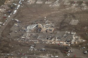 Plaza Towers Elementary after the tornado. Note the entire row of swept away homes behind it. Credit: Steve Gooch/AP
