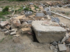 A chunk of the foundation at this leveled Rainsville home was pulled out of the ground by the force of the wind. Credit: NOAA