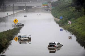 Several motorists were stranded by major flooding in the Detroit area. Portions of I-75 were shut down due to floodwaters up to five feet deep.  Source: Detroit News