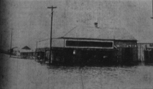 The Bruning Grocery store near the shore of Lake Pontchartrain inundated by four feet of water following the 1909 hurricane.  Source: New Orleans Daily Picayune